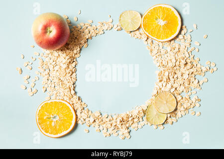 Muesli with fruit on blue background - Stock Photo