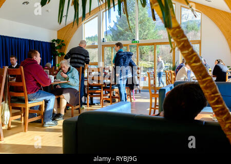 Visitors enjoying some food and refreshments in the pinemarten cafe nevis range lochaber fort william scottish highlands scotland - Stock Photo