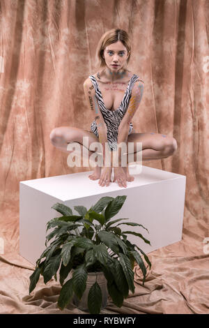Serious young woman doing a modeling job - Stock Photo