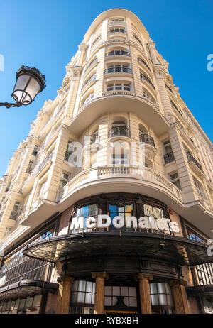 McDonalds restaurant on the corner of Gran Via and Calle de la Montera in Madrid Spain Europe. - Stock Photo