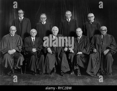 A 1976 group portrait of sitting U.S Supreme Court Justices.  William J. Brennan, Jr.; Byron R. White; Harry A. Blackmun; William H. Rehnquist; Potter Stewart; Thurgood Marshall; Lewis F. Powell, Jr.; John Paul Stevens, III; and Chief Justice Warren E. Burger. - Stock Photo