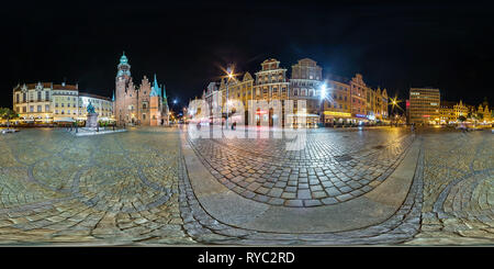 WROCLAW, POLAND - SEPTEMBER, 2018: Full seamless 360 degrees angle view night panorama on market square place of old tourist town in equirectangular p - Stock Photo