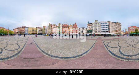 WROCLAW, POLAND - SEPTEMBER, 2018: Full seamless 360 degrees angle view panorama on Salt market square place of old tourist town in equirectangular pr - Stock Photo