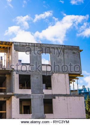 Poznan, Poland - March 9, 2019: Apartment building under construction. - Stock Photo