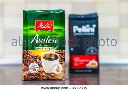 Poznan, Poland - March 9, 2019: German Melitta Auslese coffee in a 250 gram package on a wooden table. - Stock Photo