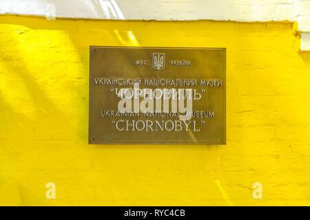 Kiev Ukrainian National Chornobyl Museum Inscription on a Yellow Colored Facade - Stock Photo