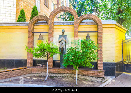 Kiev Ukrainian National Chornobyl Museum Monument of a Praying Woman with a Child and Two Bells - Stock Photo