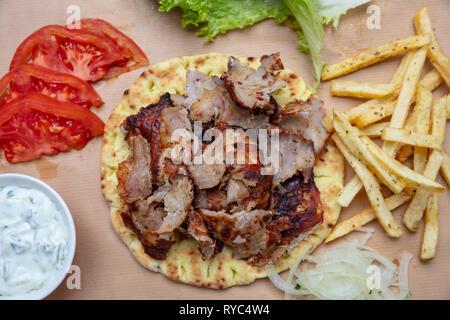 Shawarma, gyros pita. Traditional turkish, greek meat food on pita bread, top view - Stock Photo