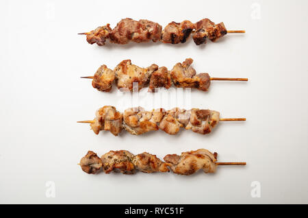 Souvlaki, meat skewers, traditional greek food, isolated on white background, top view - Stock Photo