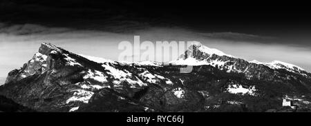 panorama mountain landscape in the Rhine Valley of Switzerland near Sargans with the castle in Balzers in the foreground in late winter - Stock Photo