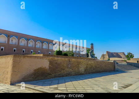 Khiva Old Town Muhammad Ibn Musa Al-Khorezmi Statue Side Viewpoint with Mohammed Amin Khan Madrasa Background - Stock Photo