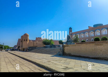 Khiva Old Town Muhammad Ibn Musa Al-Khorezmi Statue with West Gate Ota Darvoza View - Stock Photo
