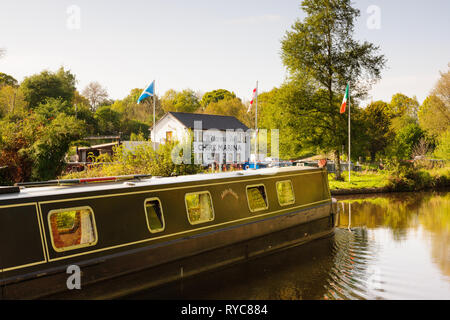 A canal barge passing the Chirk Marina on the Llangollen canal in North Wales - Stock Photo