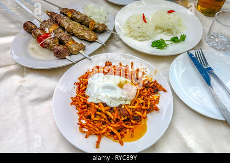 Uzbek Traditional Lamb Skewers with Rice and Fried Spicy Lagman Noodles Dish with Poached Eggs - Stock Photo
