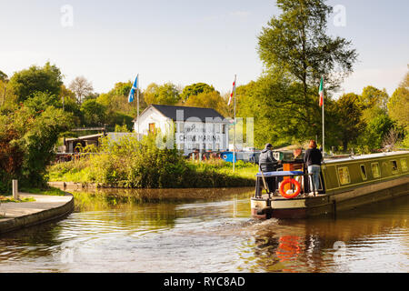 A canal barge with holiday makers passing the Chirk Marina on the Llangollen canal in North Wales - Stock Photo