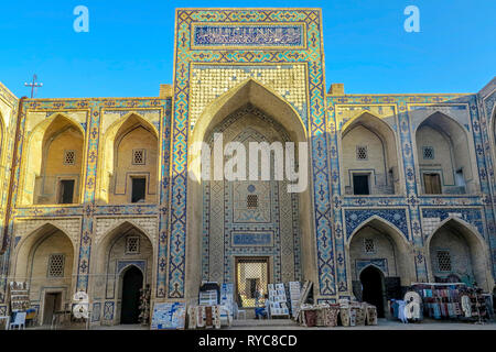 Bukhara Old City Ulugbek Madrasa Interior Iwan with Souvenir Sellers - Stock Photo