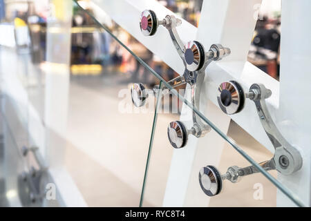 Glass facades and walls. Metal fasteners. Selective focus - Stock Photo