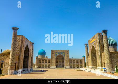 Samarkand Registon Square Ensemble Ulugbek Tilya Kori Gilded and Sherdor Madrasa Side Viewpoint at Night - Stock Photo