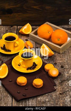 Orange French Macarons with Dark Chocolate and Coffee Filling - Stock Photo