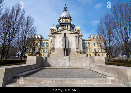 Abraham Lincoln statue standing proud in front of the state capitol building in Springfield, Illinois. - Stock Photo