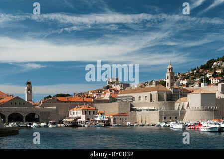 View of Dubrovnik old town harbour and boats from the sea on a sunny summer's day, Dubrovnik, Croatia - Stock Photo