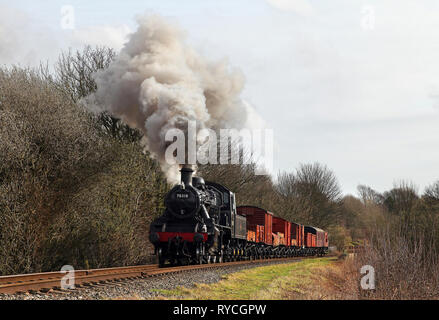78018 heads past Little Burrs with a mixed freight on the East Lancs railway. - Stock Photo