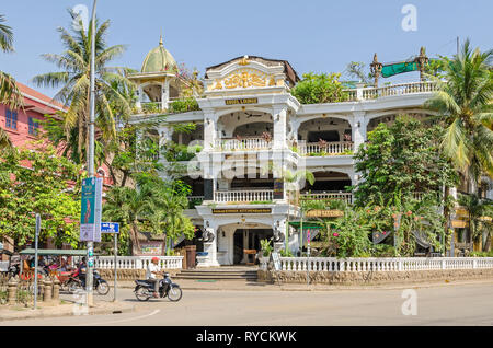 Siem Reap, Cambodia - April 12, 2018:  Boulevard Sivutha with the Terrasse des Elefants Hotel and Restaurant - Stock Photo