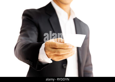 Businessman handing out business card isolated in clipping path. - Stock Photo