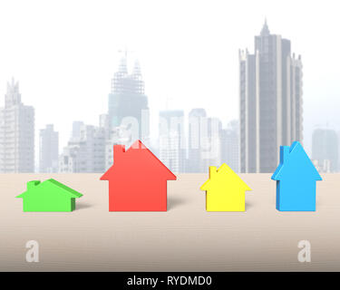 Four colorful houses on wooden table, with city skyscraper background. - Stock Photo