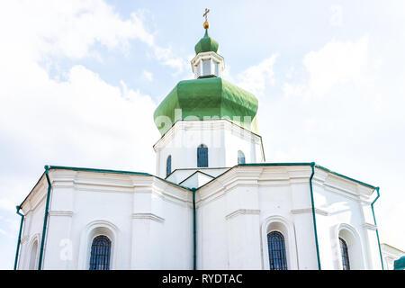 Kyiv, Ukraine Mykola Prytyska Church historic exterior orthodox religion facade during sunny day in Kiev with cupola dome closeup - Stock Photo