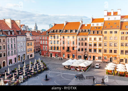 Warsaw, Poland - August 22, 2018: Historic cityscape skyline roof with high angle view of colorful architecture rooftop buildings in old town market s - Stock Photo