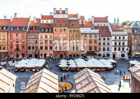 Warsaw, Poland - August 22, 2018: Old town market square with historic street during sunny summer day old market square in town with restaurants view  - Stock Photo