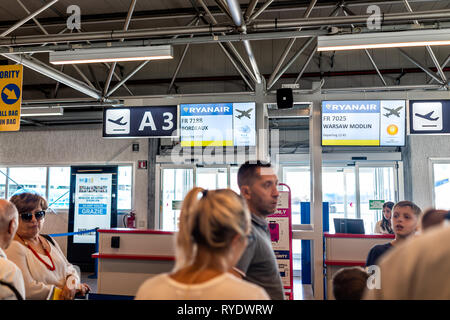 Ciampino, Italy - September 6, 2018: Many people passengers waiting to board late Ryanair airplane domestic European Union flight low-cost cheap airli - Stock Photo