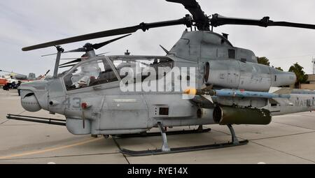 A U.S. Marine Corps AH-1Z Viper attack helicopter at MCAS Yuma. This AH-1Z Viper belongs to the VMX-1 squadron. - Stock Photo