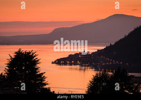 Lake Iseo with the town of Peschiera Maraglio on Monte Isola at dawn, Lombardy, Italy - Stock Photo