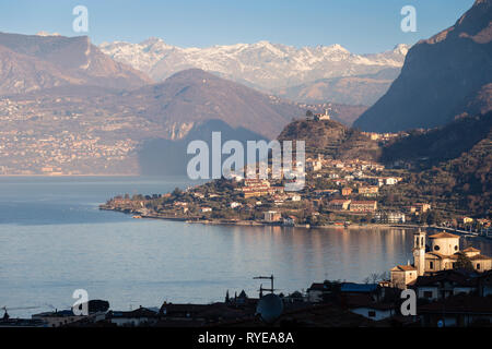 Lake Iseo seen from Sale Marasino to the north and the Alps - Stock Photo