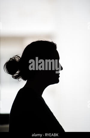 Young woman, silhouette. White backgrounds - Stock Photo