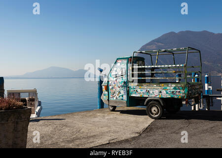 Ape Car by the Lake, Monte Isola, Iseo lake, Italy - Stock Photo