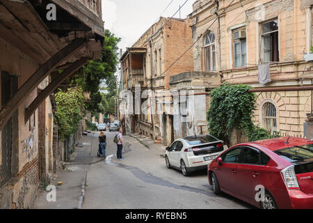 TBILISI, GEORGIA - SEPTEMBER 22, 2018: Dilapidated houses in narrow streets of the old town, Sololaki district, Tchaikovsky street - Stock Photo