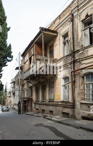 TBILISI, GEORGIA - SEPTEMBER 22, 2018: Dilapidated houses in narrow streets in old town, Sololaki district, Tchaikovsky street - Stock Photo