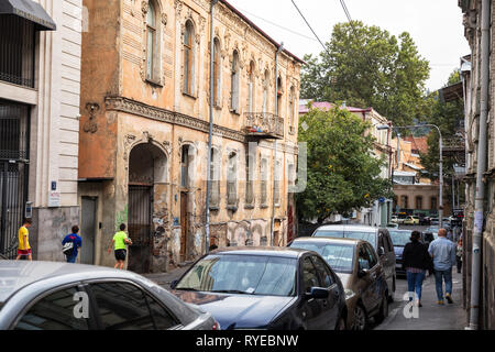 TBILISI, GEORGIA - SEPTEMBER 22, 2018: Old mansion with stucco decorations in the old town, Sololaki district, Pavle Ingorokva street - Stock Photo
