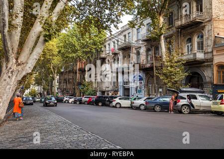 TBILISI, GEORGIA - SEPTEMBER 22, 2018: Old town Tbilisi, one-way street, cars parked along the sidewalk, Sololaki district, Giorgi Leonidze street - Stock Photo