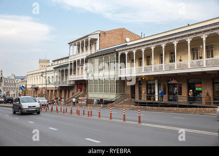 TBILISI, GEORGIA - SEPTEMBER 22, 2018: Views of Tbilisi, old houses with traditional carved balconies on Pushkin Street - Stock Photo