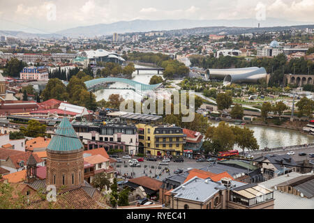 TBILISI, GEORGIA - SEPTEMBER 23, 2018: Scenic panoramic view of Tbilisi. New modern architecture is adjacent to the old quarters - Stock Photo