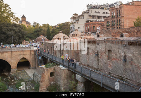 TBILISI, GEORGIA - SEPTEMBER 23, 2018: Abanotubani Sulfur Baths district of Tbilisi is very popular with tourists and locals - Stock Photo