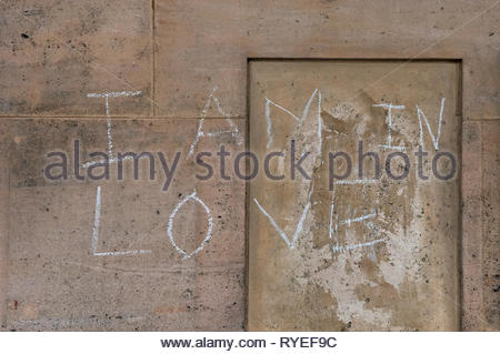 I Am In Love Written In Chalk On A Wall - Stock Photo