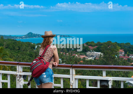 Tourist girl standing on observation deck Lamai viewpoint in Samui island, Thailand - Stock Photo