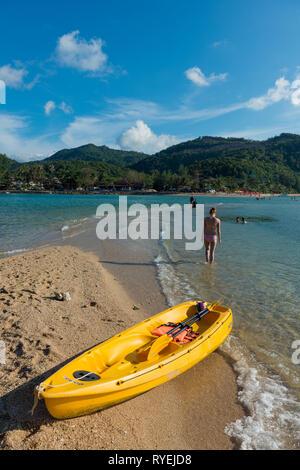 Yellow kayak in Ko Ma island beach near Phangan island, Thailand - Stock Photo