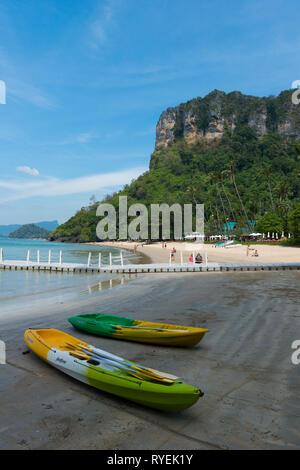 Two kayaks on Centara Grand beach near Ao Nang, Krabi province, Thailand - Stock Photo