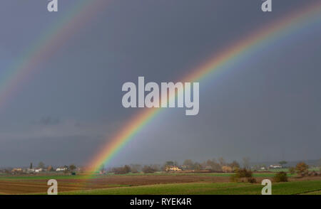 Beautiful rainbow over the countryside of the province of Pisa, Tuscany, Italy, Europe - Stock Photo
